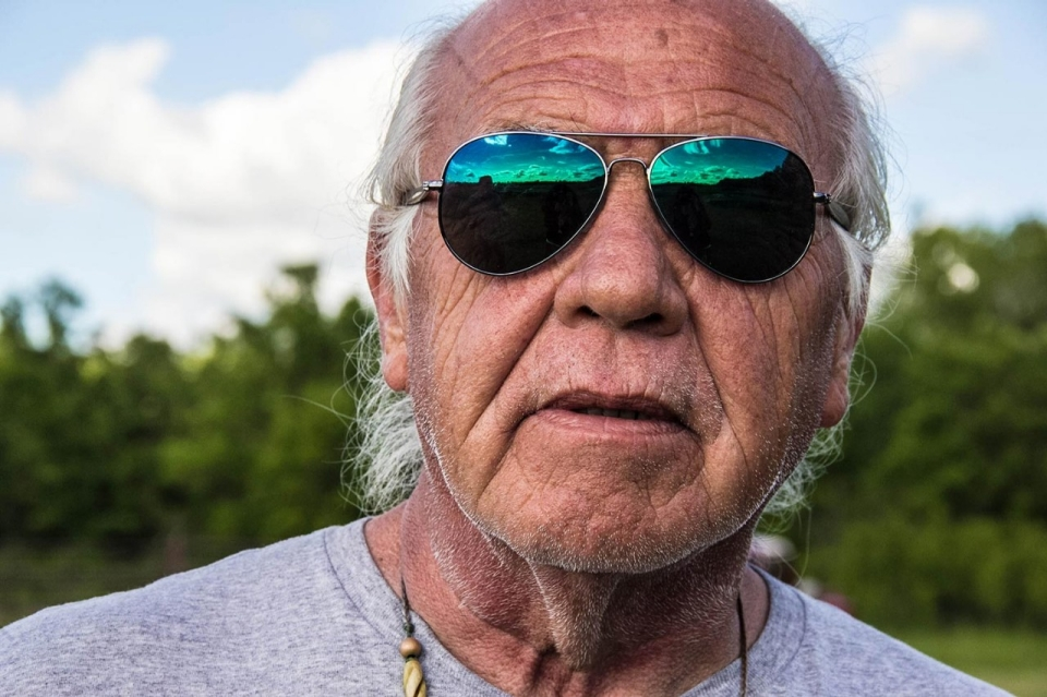 Leonard Thompson, Todd Thompson's father, with the sky over Lower Rice Lake reflected in his sunglasses. © Jolene Yazzie for Al Jazeera America